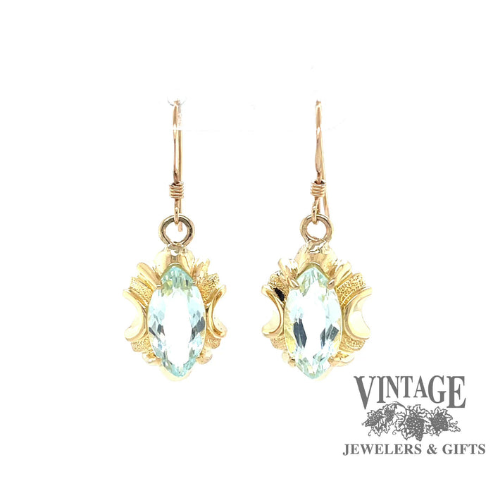 Revolving video of 14 karat yellow gold marquise shaped aquamarine drop earrings