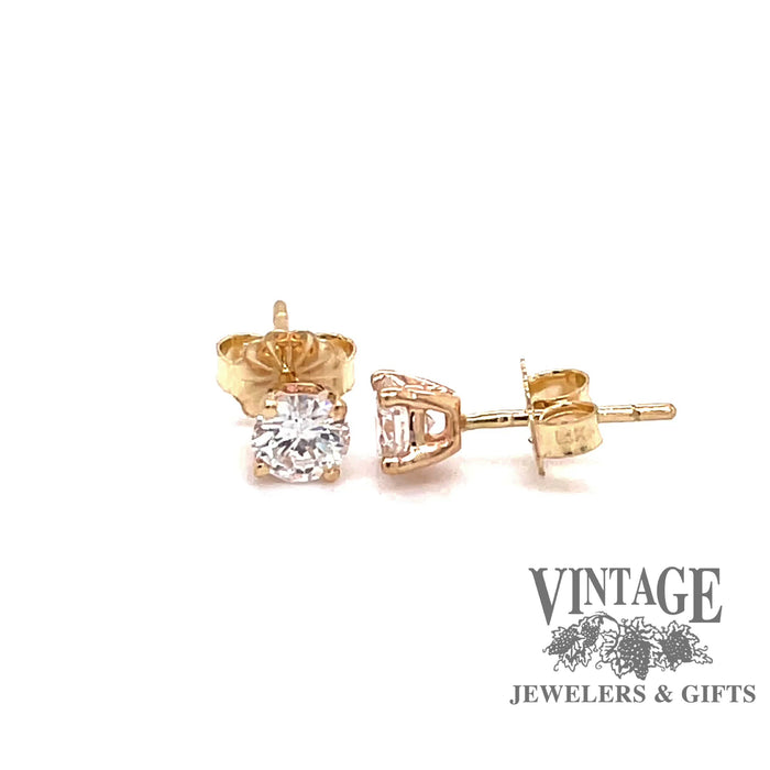 Revolving video of 14 karat yellow gold .66 carats total weight diamond stud earrings