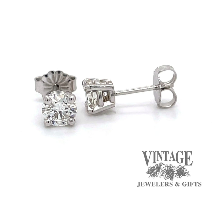 Revovling 360 degree video of 14 karat white gold .97 carat total weight diamond stud earrings.