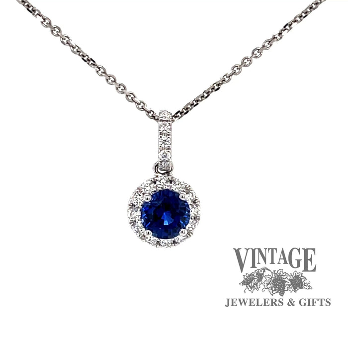 Revolving video of 18k white gold Blue sapphire and diamond halo pendant