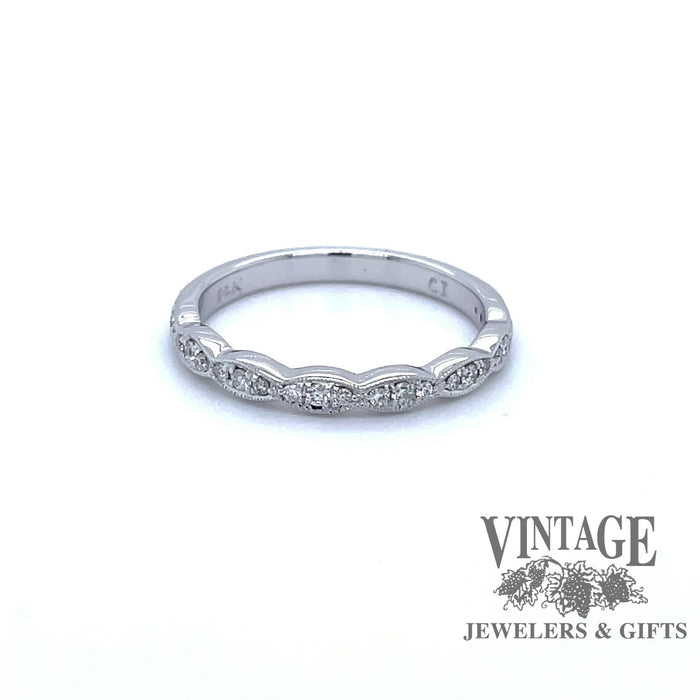 Revolving video of 14 karat white gold diamond band.