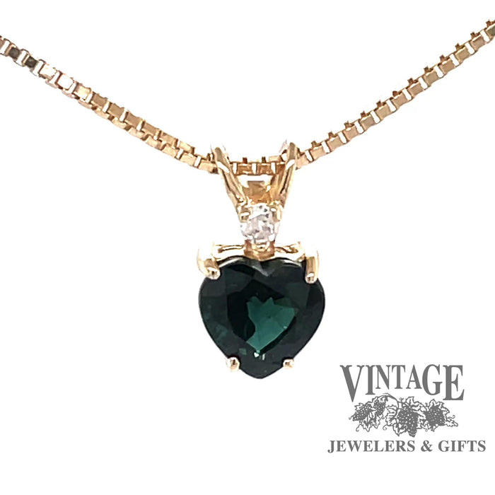 Revolving video of 14 karat yellow gold heart shaped sapphire pendant