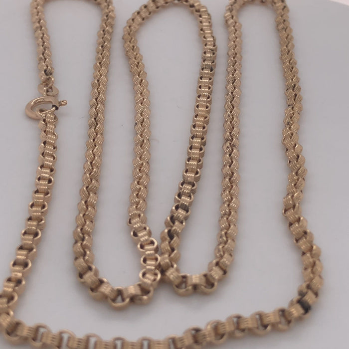 Revolving video of18 karat yellow gold medium weight cable chain with fluted links.