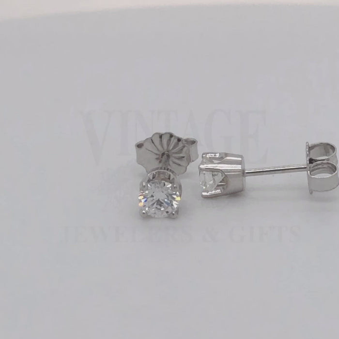 Video of 14 karat white gold .50 carat total weight diamond stud earrings.