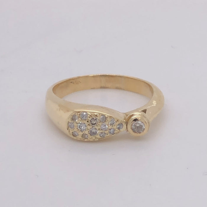 18 karat yellow gold pave' diamond ring with 1 bezel set diamond