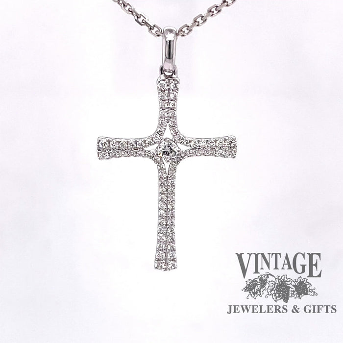 Revolving video of 14 karat white gold diamond cross