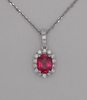 18 karat white gold natural spinel in diamond halo pendant.