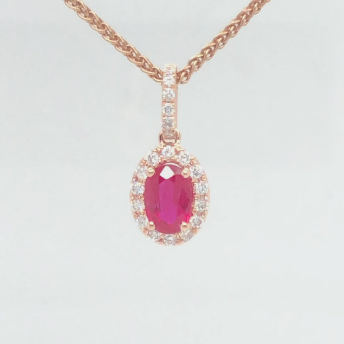 14 karat rose gold ruby halo diamond pendant from 360 degrees.t