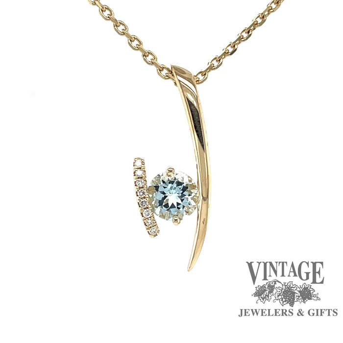 Revolving video of14k yellow gold Aquamarine and diamond contemporary pendant