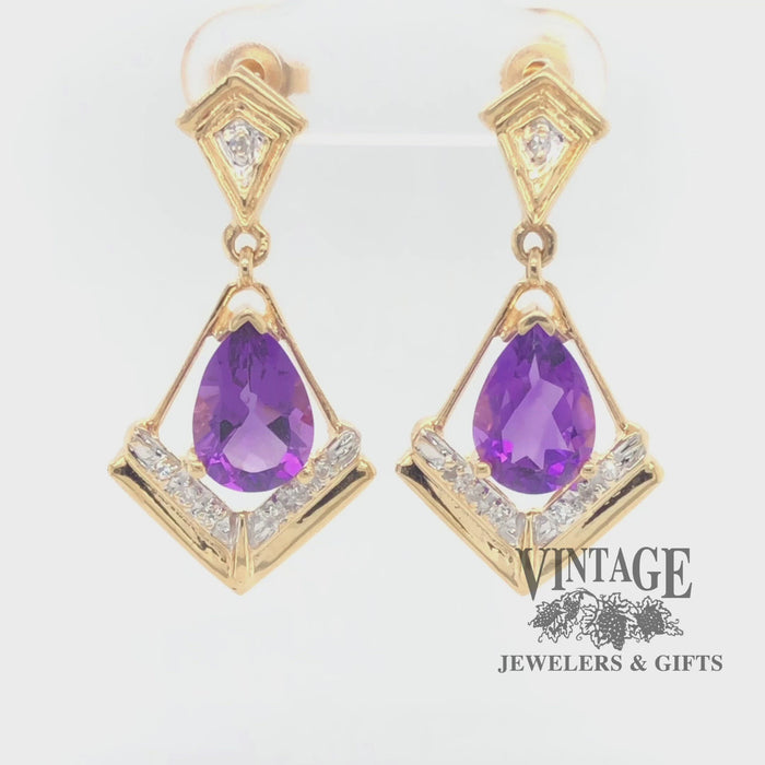 Revolving video of 14 karat yellow gold amethyst and diamond drop earrings