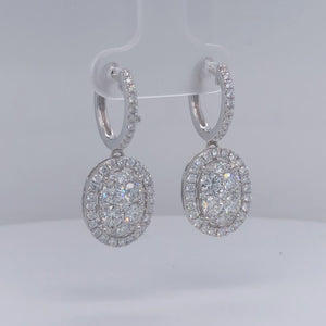 White gold diamond pave' drop earrings with diamond lever backs.