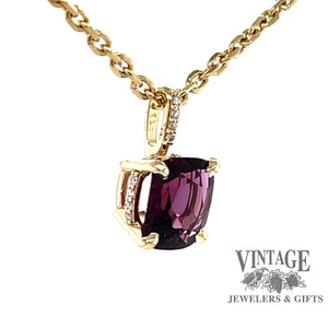 Revolving video of 14 karat yellow gold Pink spinel and diamond pendant
