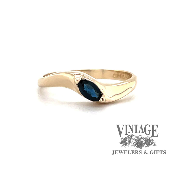 Revolving video of 14 karat yellow gold blue marquise sapphire ring