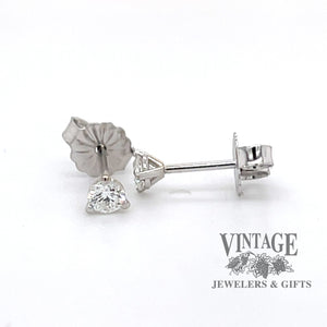 14k white gold .20 C.T.W. diamond studs, martini style mountings.