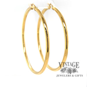 Extra large 60 mm 14k hoop earrings from side angle