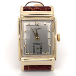14 karat yellow gold retro Hamilton wristwatch with crocodile grain leather strap, front view.