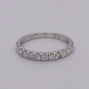 18 karat white gold diamond band with 13 round brilliant diamonds.
