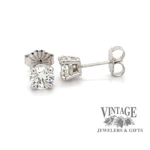 14 karat white gold .97 carat total weight diamond stud earrings.