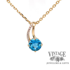14 karat yellow gold round blue topaz pendant with diamonds