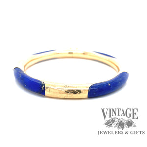 Lapis and 14 karat gold hinged bangle bracelet.