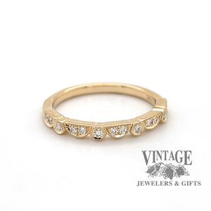 14 karat gold .15 carat toatl weight diamond wedding band, front view.