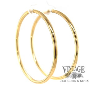 Endless extra large 14k gold hoops, side angled view