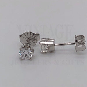 .50 carat total weight 14 karat white gold diamond stud earrings from front and side view.