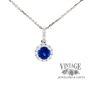 18k white gold Blue sapphire and diamond halo pendant, front view