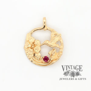 14k gold ruby hummingbird pendant, front view.