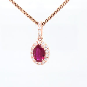 14 karat rose gold ruby halo diamond pendant front view.