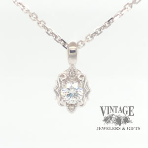 Embossed 14 karat white gold diamond pendant, front view
