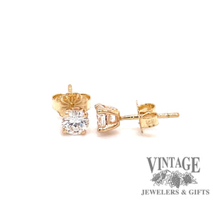 14 karat yellow gold .66 carats total weight diamond stud earrings