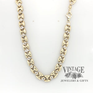"17.5"" 10 karat two tone gold bezel set diamond link chain necklace."
