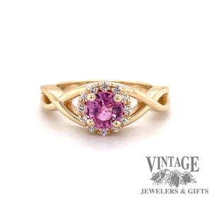 Custom 14 karat yellow gold  pink sapphire with diamond halo ring, front view