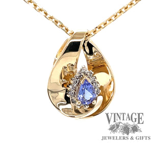 14 karat yellow gold tanzanite slide pendant with halo diamonds