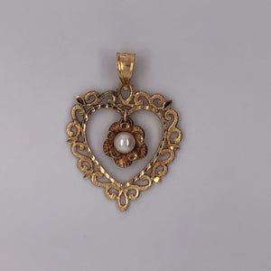 14 karat yellow gold heart pendant with pearl.