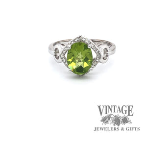 14 karat white gold peridot and diamond ring.