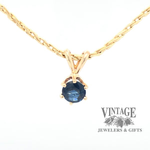 14 karat yellow gold round natural blue sapphire solitaire pendant, front view