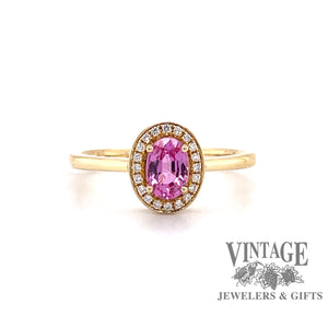 14 karat yellow gold oval pink sapphire and diamond  halo ring, front