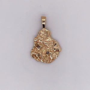14 karat yellow gold cast nugget pendant.