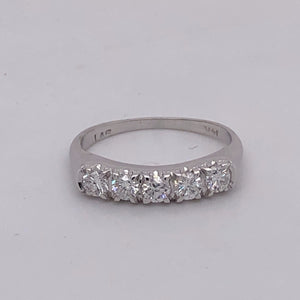 14 karat white gold with 5 round brilliant cut diamond band.