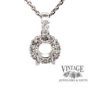 .18cts total weight white gold halo diamond pendant