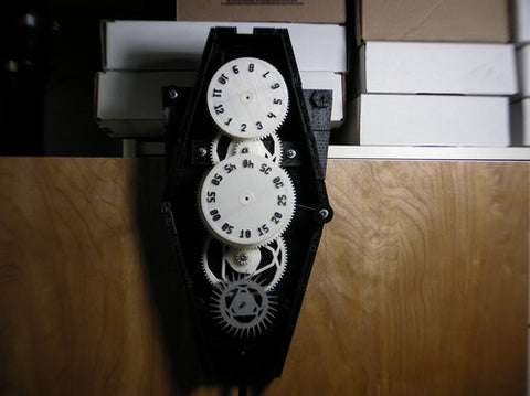 "<strong>1st Place</strong> - Gravity Clock by <a href=""http://www.reddit.com/user/rustedrobot"" target=""_blank"">rustedrobot</a>. <strong><a href=""http://fe2.net/projects/printableclock_v1/index.html"" target=""_blank"">Source</a></strong>"