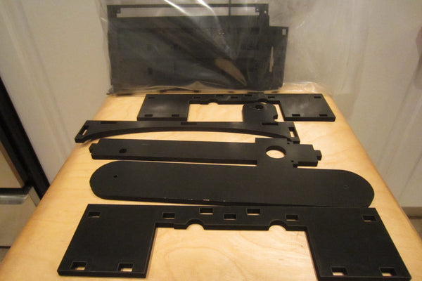 Laser cut melamine boards.  Except for one piece that had some dings, the pieces all seem to be in good order.