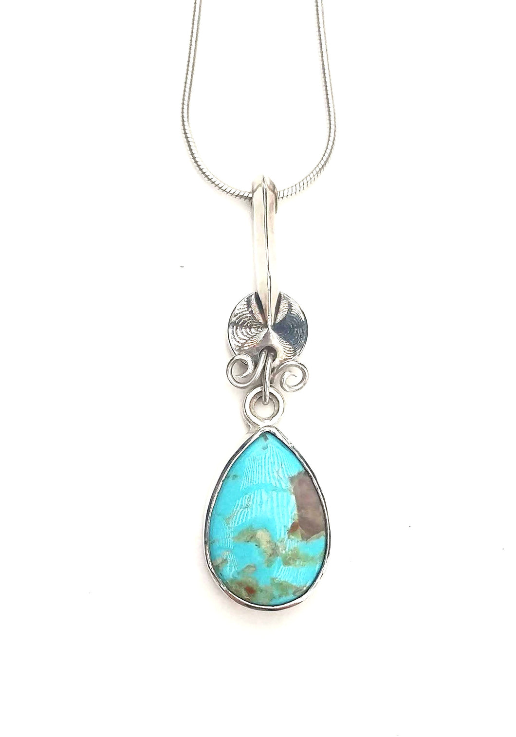 Cumpas turquoise and clarinet key pendant