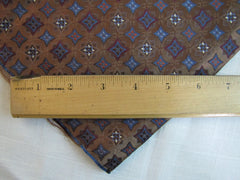 Brown and Red silk Necktie Tip measured by wooden ruler