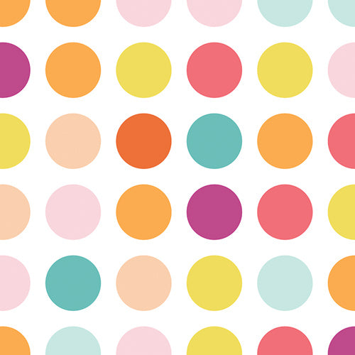 Colorful candy dots on a white fabric