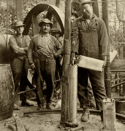 Filling Shell With Nitro-Glycerine Preparatory To Shoot 1920
