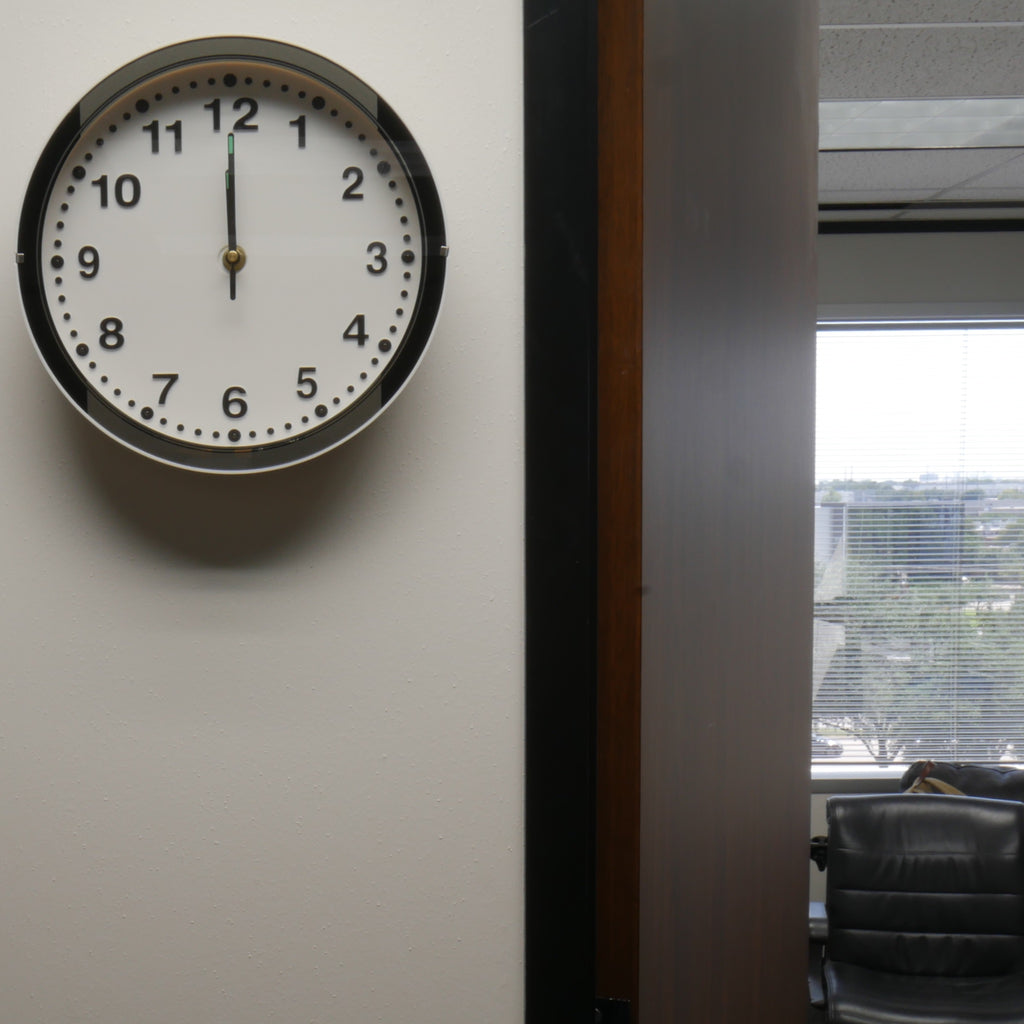 Wall Clock Speaker Camera in Office