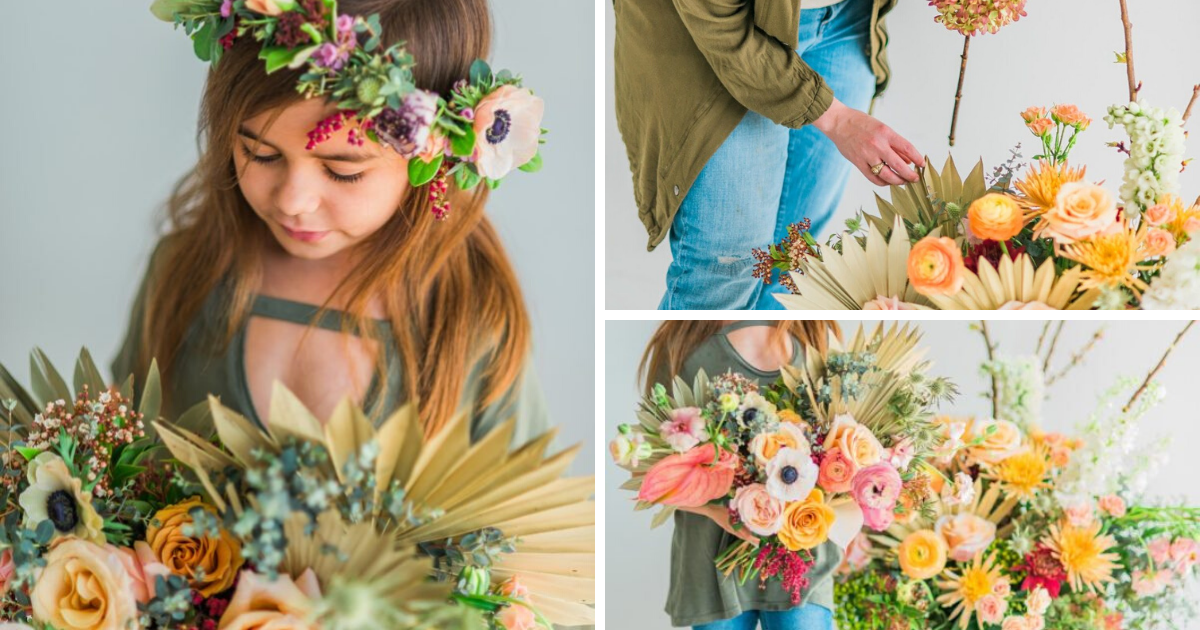 Little girl with flower crown holding a bouquet of colorful and tropical flowers and palm leafs.